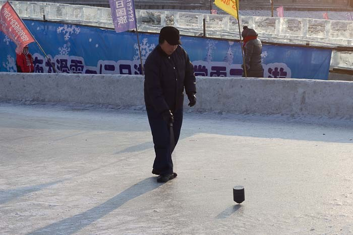 Playing tuo-luo, ice spinning tops, on the Songhua River.