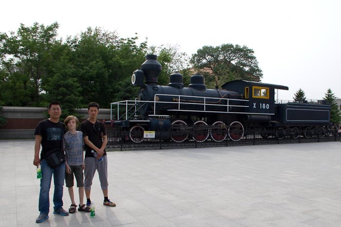 "Zac with Dongchao and friend, and a ""timber-fuelled"" train - Changchun."