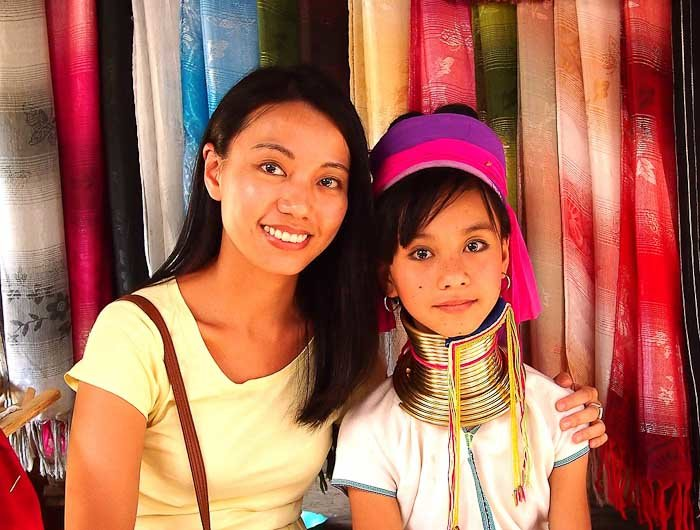 "Thai photographer with young girl from the Karen ""long neck"" hill tribe, Thailand."