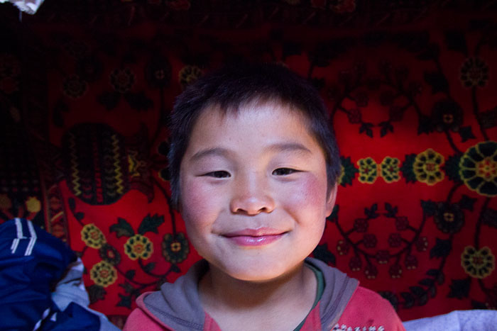 7-year-old Mongolian boy photographed in his ger.