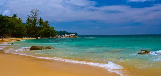 Thai beach with blue seas, sand and palm trees via John Lembo.