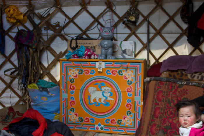 Storage chest, trellis framework and possessions in a Mongolian ger. Oh, and a baby.
