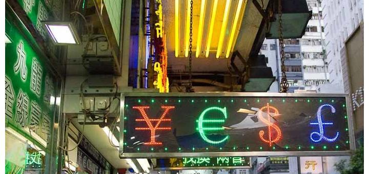 Sign reading YES made with yen, euro and dollar signs - TST, Hong Kong.