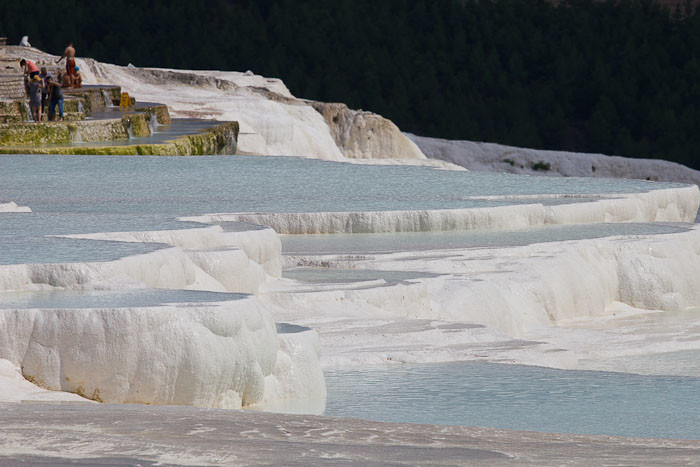 The travertine hot springs at Pamukkale, Turkey, glisten in the sun.