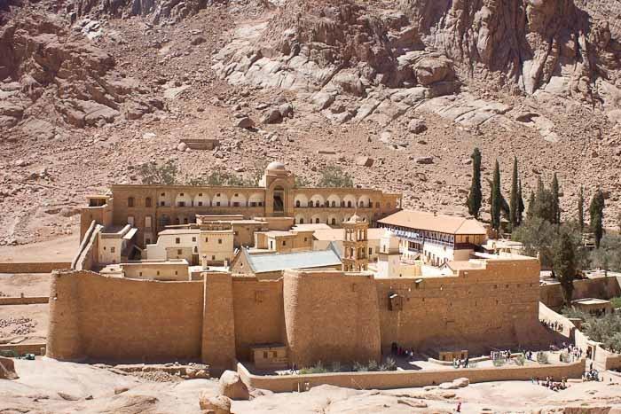 Saint Catherine's Monastery, Sinai, framed by cypresses.
