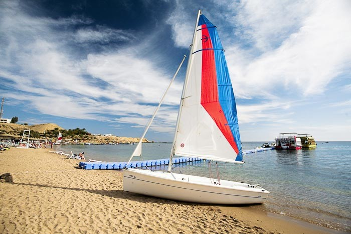 Boat on beach at Sharm - image by Svetlana Grechkina.