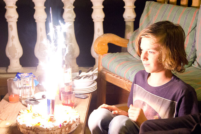 Zac with sparklers on his cake in Dahab.
