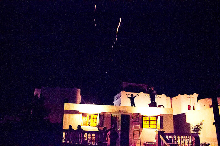 Zac and Tyler setting off fireworks on the roof of our house.