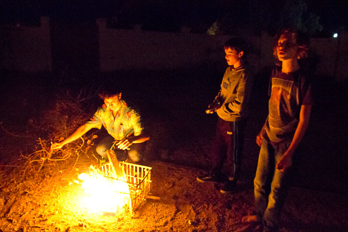 Zac, Lee and Tyler tending the flames.