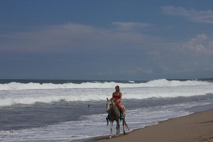 Horse riding on Seminyak Beach, Bali.