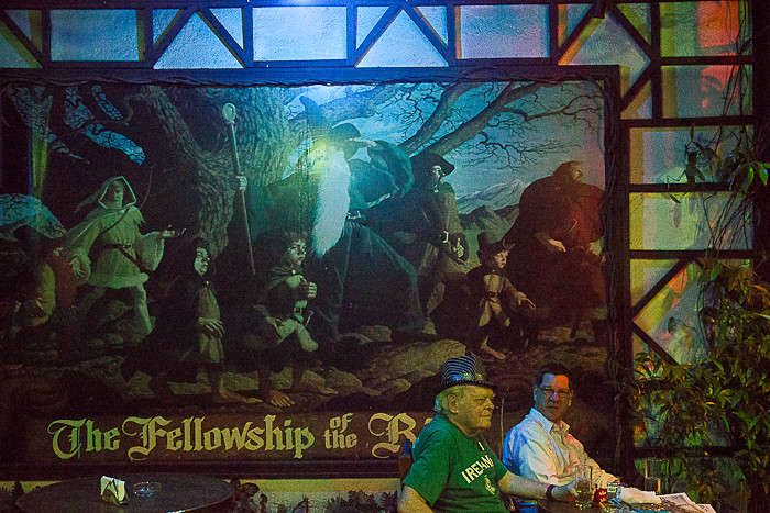 Jim, the owner of Hobbit House, in front of a Fellowship of the Ring artwork.