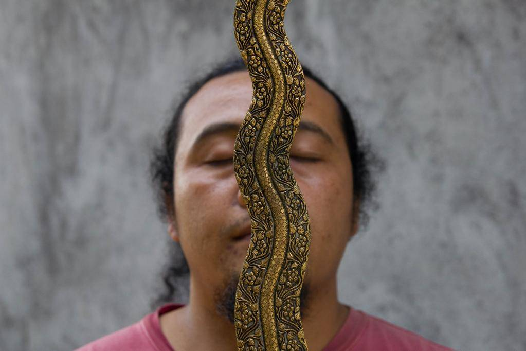 Balinese kris-maker Empu Nyoman Punduh with his masterwork.