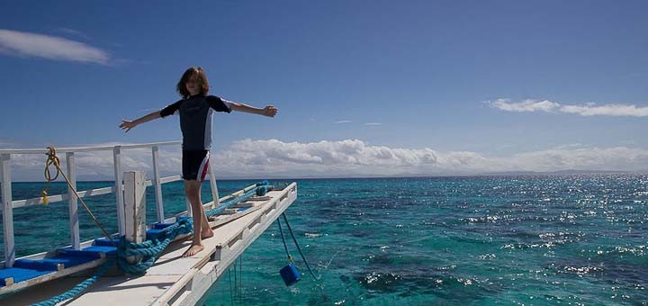 Zac balanced on an outrigger dive boat in Malapascua, Philippines.