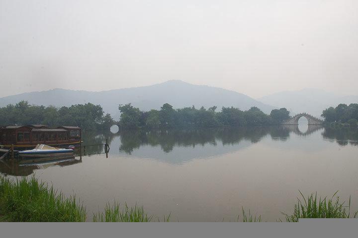 Bridges and mountains reflect in Xianghu Lake, Hangzhou, China.