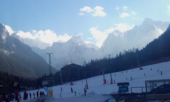 Skiing at Kranjska Gora, with mountains in the distance.