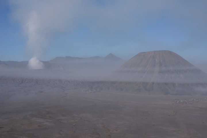 Mist swirls around the volcanos of Bromo, Java.