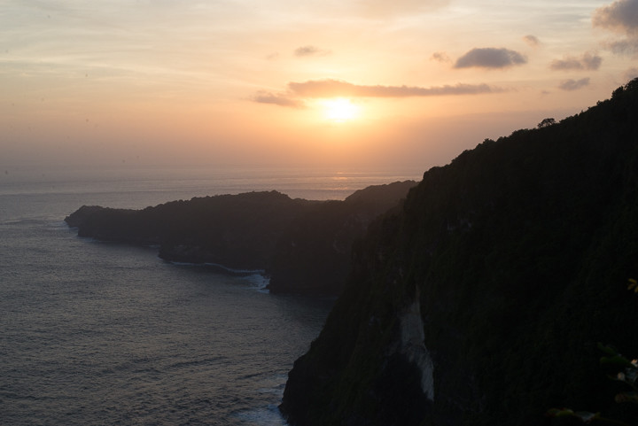 Sunset over the coast of Nusa Penida, Bali.