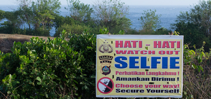 A sign at Broken Bay, Nusa Penida, Indonesia, warns against taking selfies.